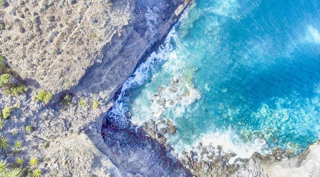 Overhead view of rocks along ocean