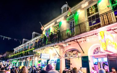 NEW ORLEANS - FEBRUARY 9, 2016: Tourists and locals enjoy Mardi