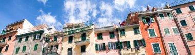 Cinque Terre, Beautiful Village of Riomaggiore with blue boats i