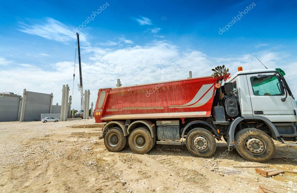 Moving truck in building construction site