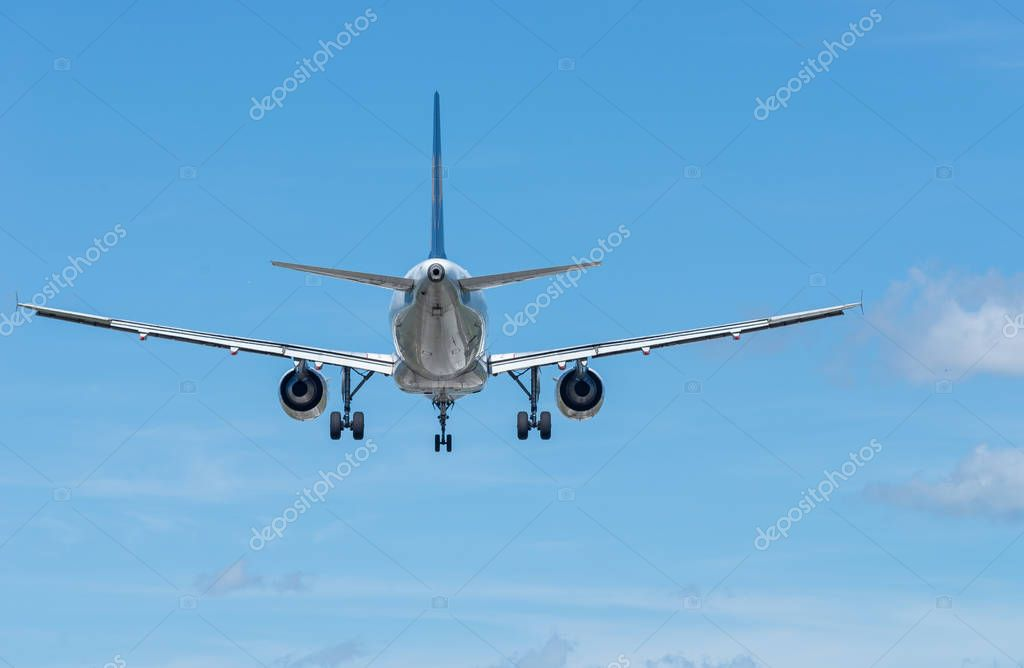 Airplane landing, back view