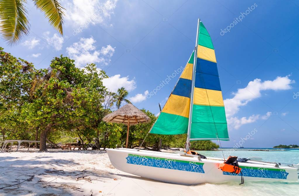 Beautiful catamaran on a tropical beach