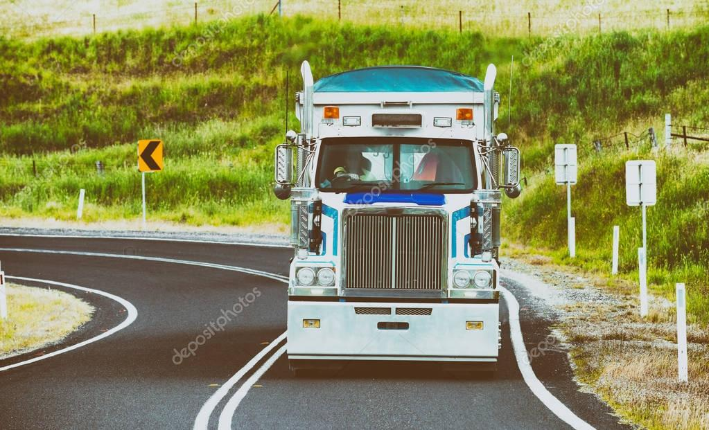 Big truck speeding up in beautiful countryside