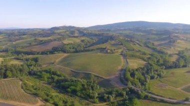 Overhead aerial panoramic view of meadows in Tuscany, Italy. Video