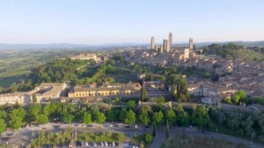 amazing aerial sunset view of San Gimignano medieval town in the province of Siena, Tuscany, Italy. Video