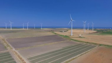 aerial view of industrial windmills at countryside. Video