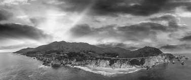 Big Sur panoramic aerial skyline at sunset, black and white view of California.