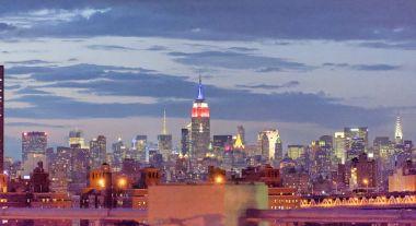 Midtown Manhattan night skyline from Brooklyn Bridge, New York City.
