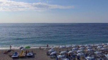 amazing beach with umbrellas and ocean coast, video