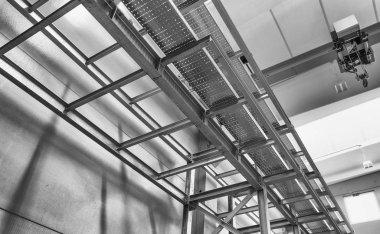 Modern metallic structure inside a warehouse. Empty environment.