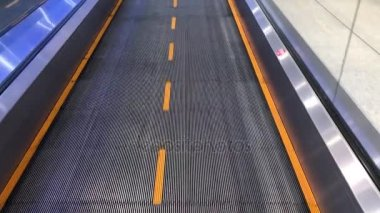 Walking on airport treadmill, first person view