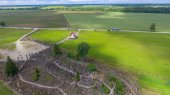 Photo Hill of Crosses, Lithuania. Beautiful aerial view in summer seas
