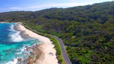 amazing aerial view of road along ocean coast, video
