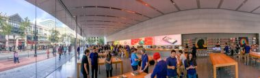 PORTLAND, OR - AUGUST 18, 2017: Tourists and locals in the Apple Store. Apple is a famous technology company.
