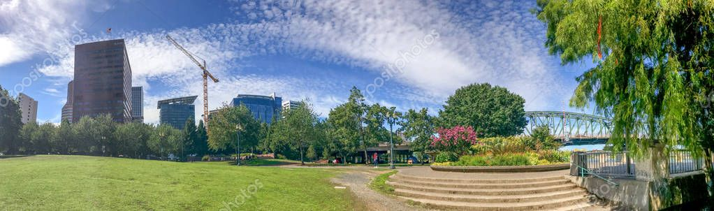 PORTLAND, OR - AUGUST 18, 2017: Panoramic view of city park. Portland attracts 5 million tourists annually.