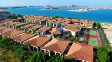 aerial view of beautiful houses at Palm Jumeirah artificial archipelago in Dubai,  United Arab Emirates