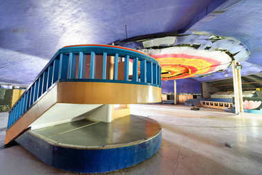 Abandoned discotheque with wooden colorful interior.