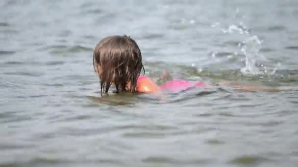 little girl relaxing in  water, summer vacation