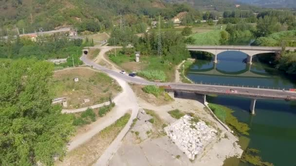 aerial view of bridges across river and picturesque nature