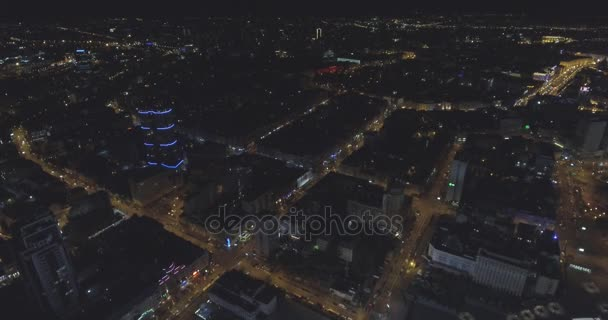 aerial view of Kyiv city skyline buildings at night. urban metropolis background. establishing shot of nyc. Aerial night vertical view of skyscraper rooftops and illuminated streets in a modern city.