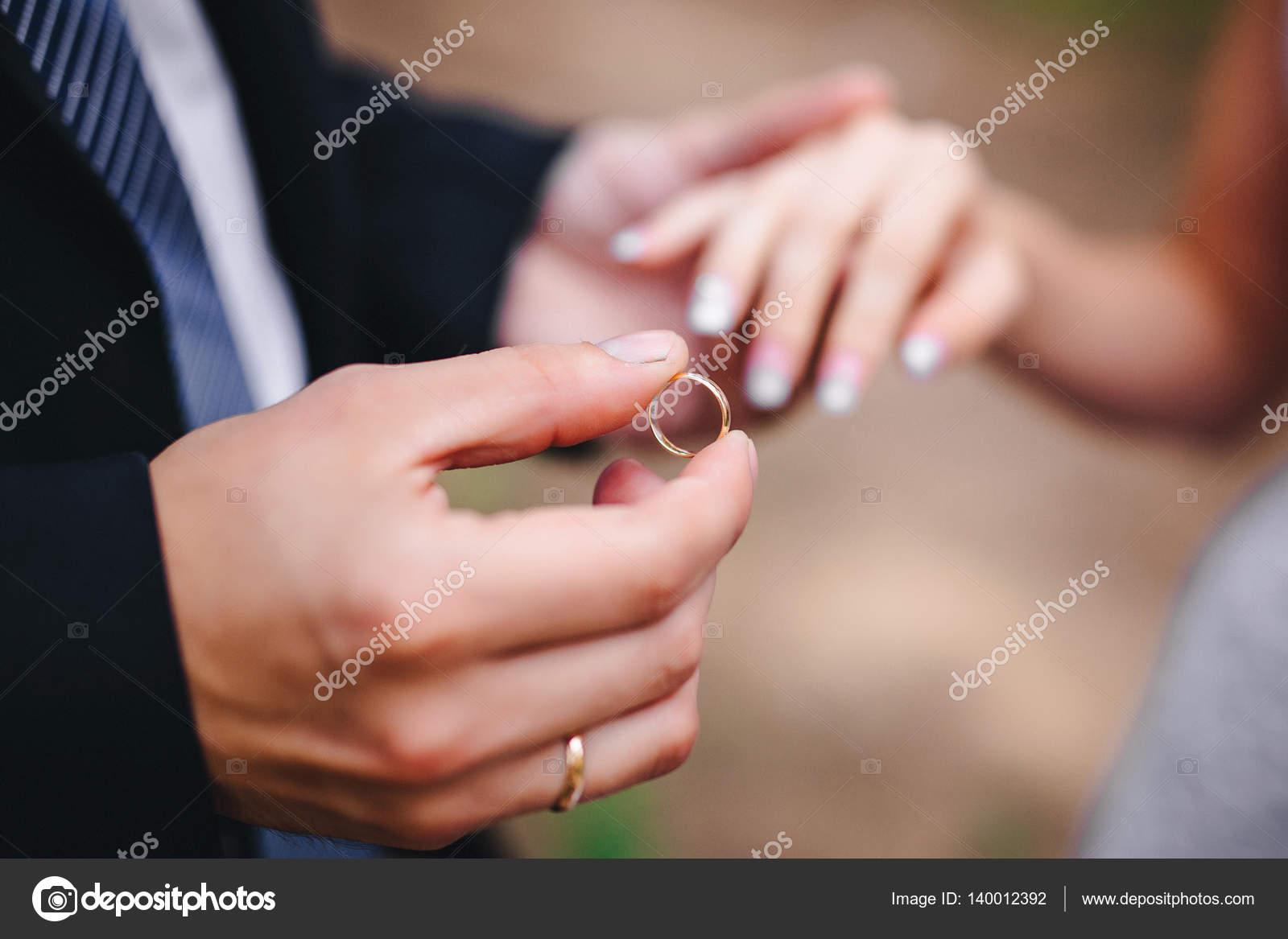 groom wears the ring bride — Stock Photo © Anasteisha #140012392