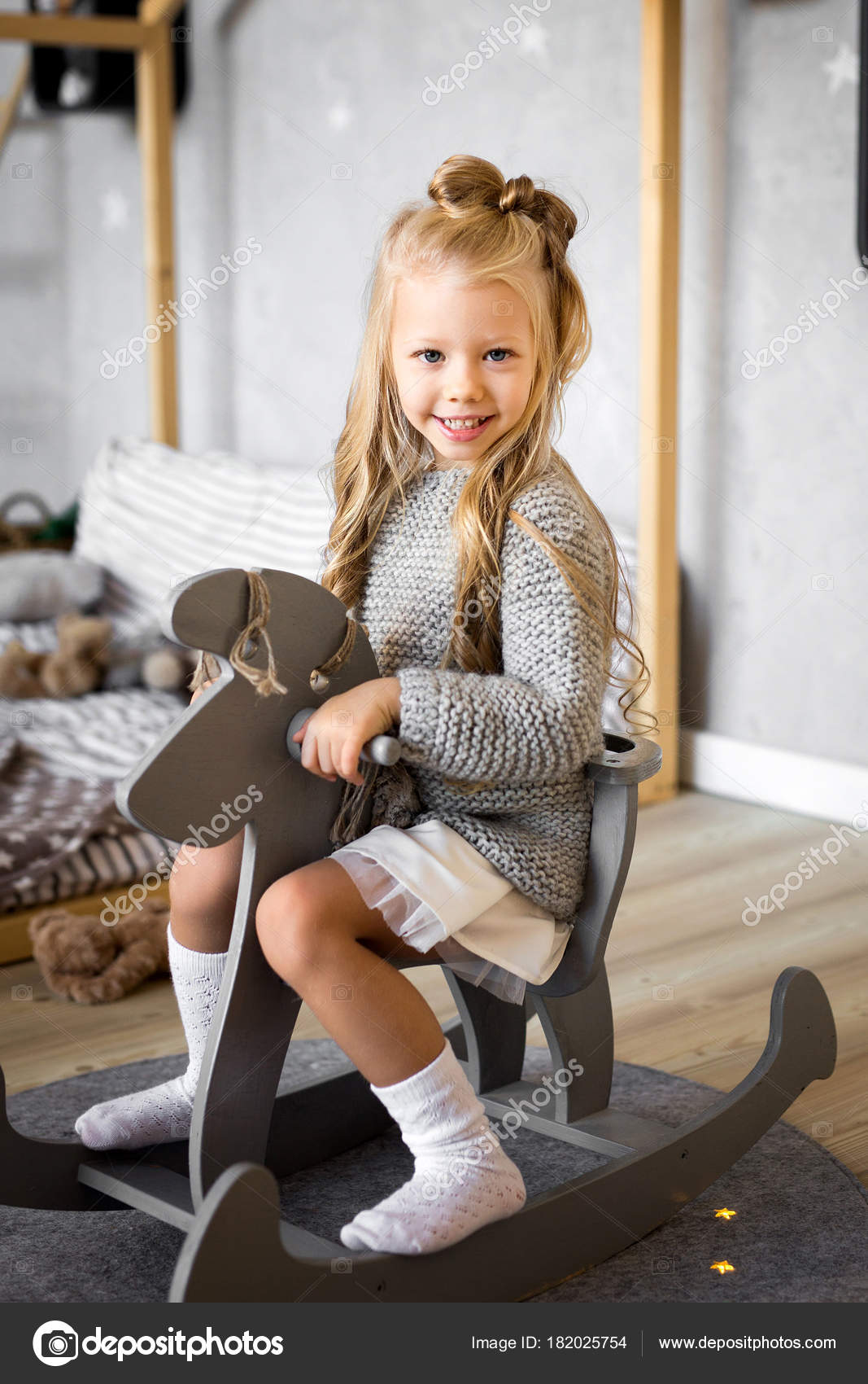 Happy Little Girl Riding Toy Horse Room