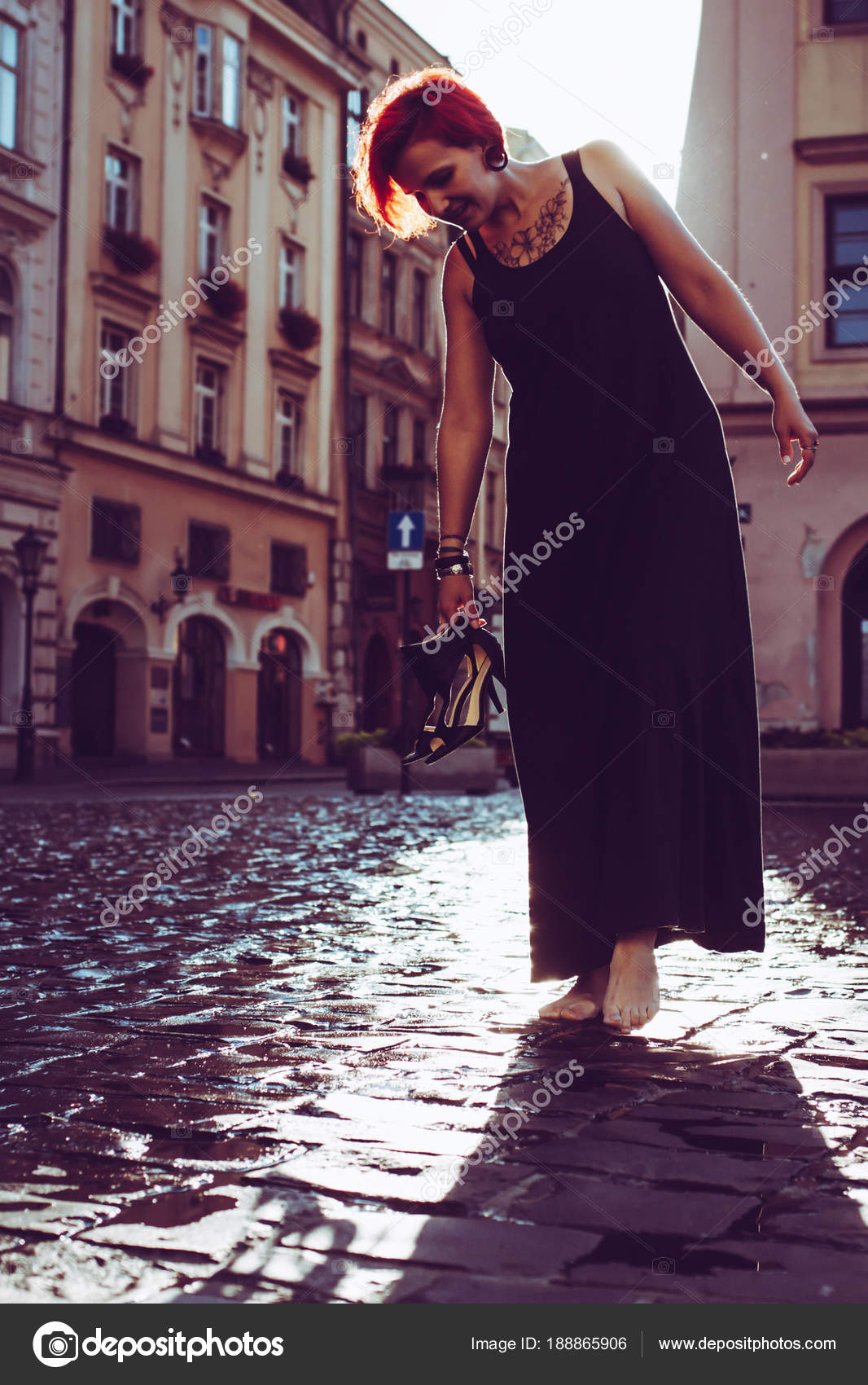 https://st3.depositphotos.com/1001194/18886/i/1600/depositphotos_188865906-stock-photo-red-hair-young-woman-walking.jpg