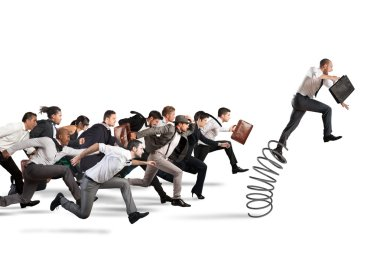 Businessman jumping on a spring