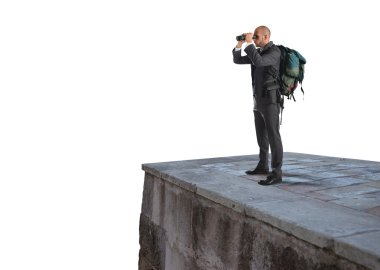 Businessman with backpack and binoculars watching