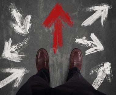 Businessman deciding direction and follows the red arrow stock vector