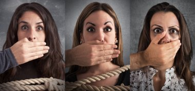 hands covering the mouths of a women