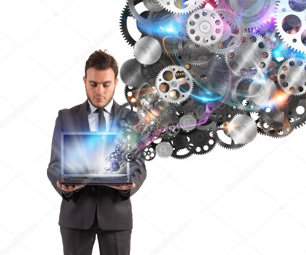 Businessman holds a laptop