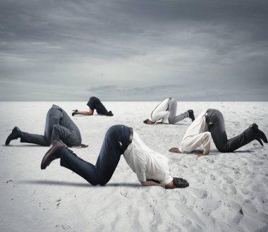 Afraid business people hide their heads