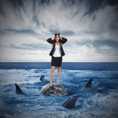 Businesswoman yelling on a rock