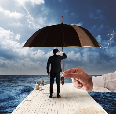 Man covered by an umbrella while watching the horizon from a pier with stormy sea stock vector