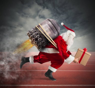Santa Claus with gift box runs