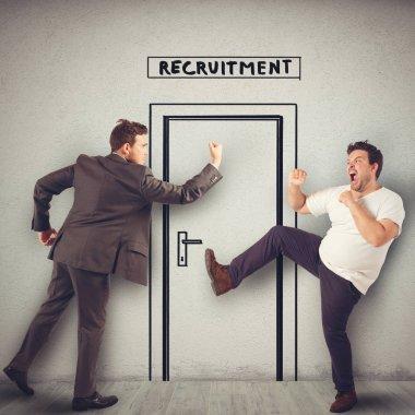 Businessmen are fighting in front of the door