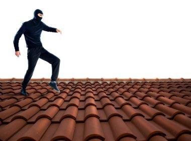 Thief dressed in black walking