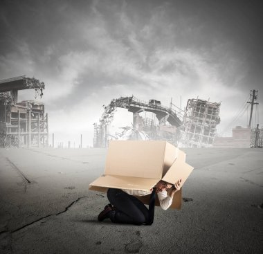 businessman is hiding under a cardboard