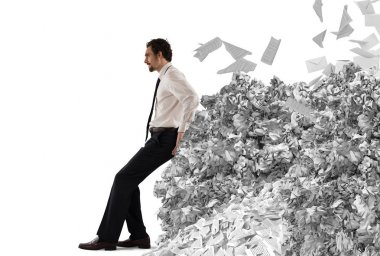 Businessman pushing with fatigue a big pile of paperwork stock vector