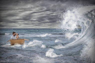 Businessman in a cardboard sails