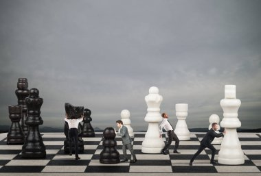 Businessmen move the chess pieces.