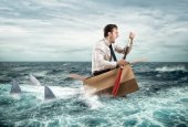 Businessman escapes  from sharks