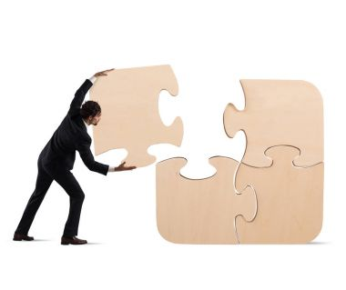 Businessman complete a big puzzle