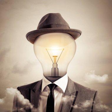 Man with a light bulb as head.