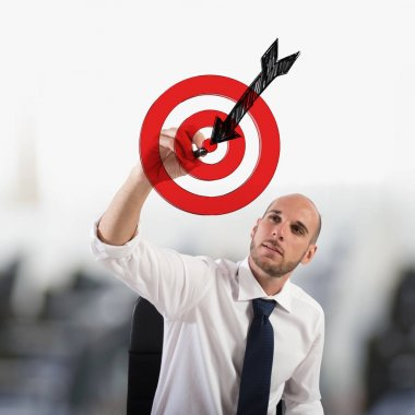 Businessman drawing a target