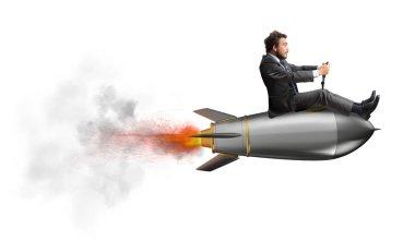 Businessman flying on a fast rocket.