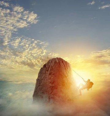 Businessman climbing  a mountain