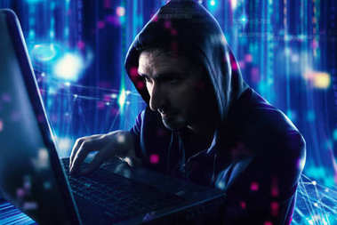 Hacker reading personal information on a computer. Concept of privacy and security
