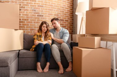 Confused couple of having to move and arrange all the packages to new home. Concept of success, delusion, change and future stock vector